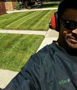 Lawn care provider cutting a lawn in Hazel Park, Michigan