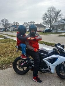 Father and son ride motorcycles in Hazel Park