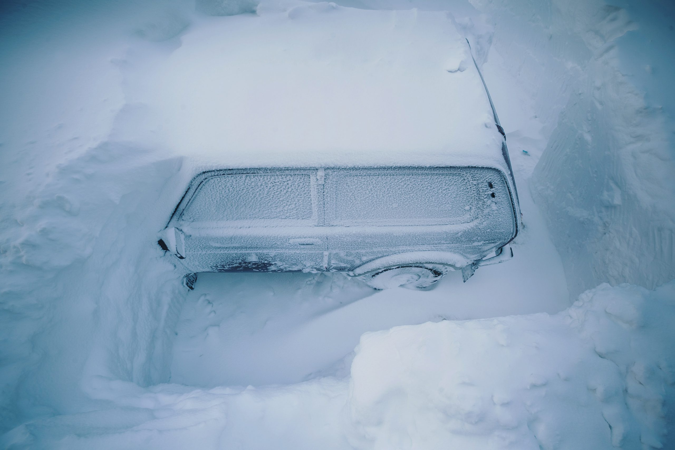 Vehicle covered in snow
