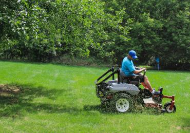 A LawnGuru Professional mowing a lawn in Ann Arbor, Michigan